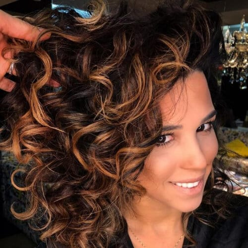 Medium Curly Brunette Shag with Baby lights